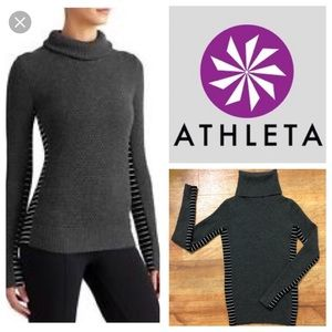 Athleta woven turtleneck sweater.